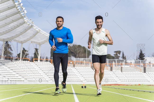 Caucasian and African American male athlete practicing at a sports track