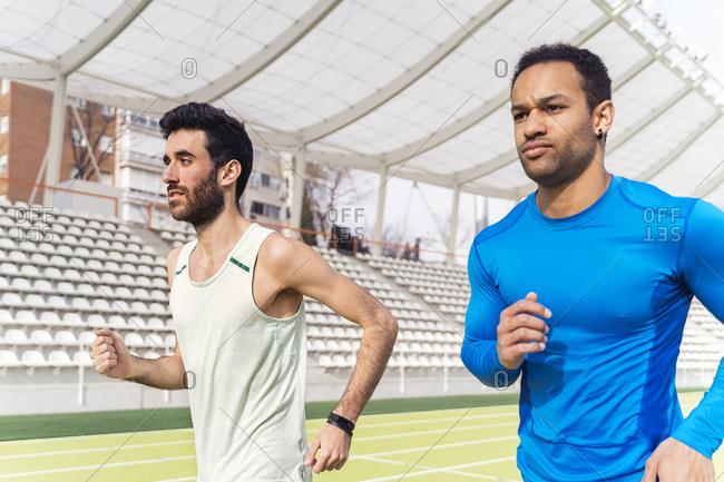 Two male athlete practicing at a sports track