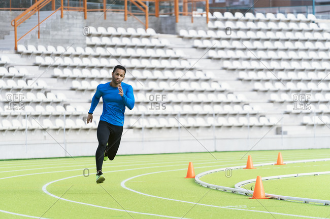 An afro American man running on a track