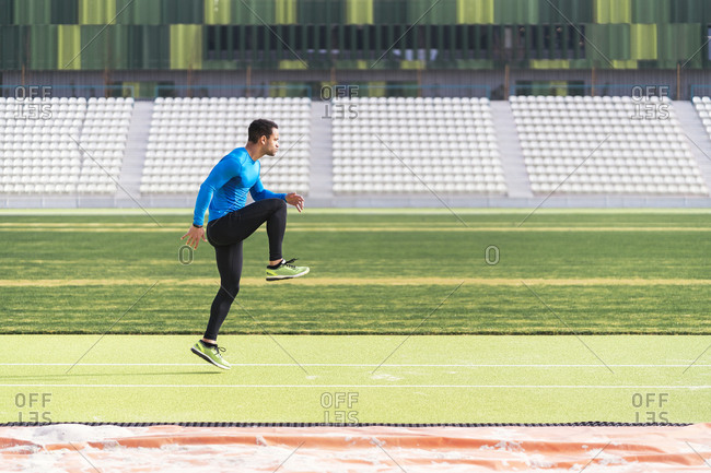 African American male athlete practicing on an athletic track