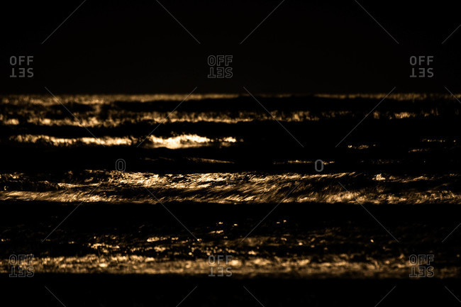 Abstract view of waters and waves in golden tone