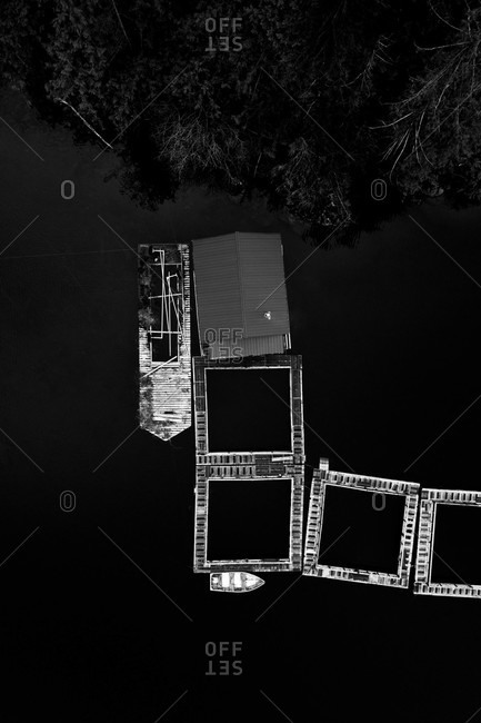 Aerial view over boat dock in black and white
