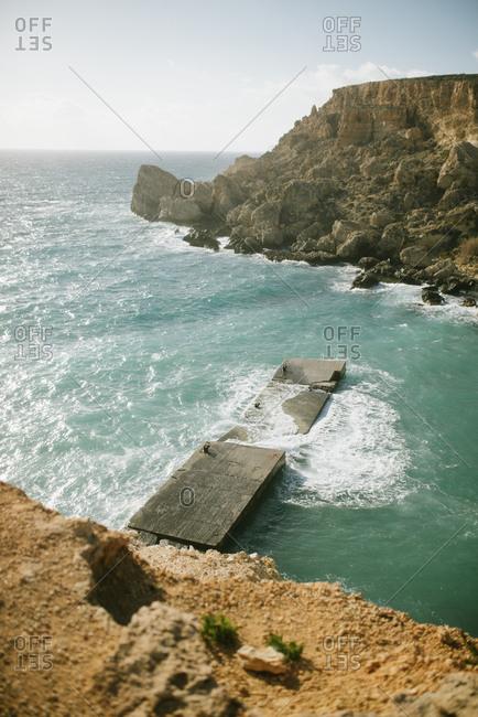 Waves crashing around Malta Cliffs
