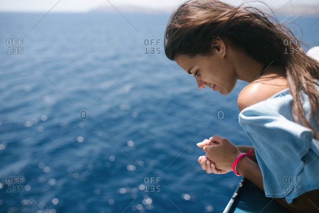 Portrait of a young woman on a ferry boat
