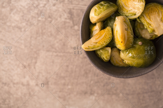 Overhead view of baked green brussels sprouts in a bowl