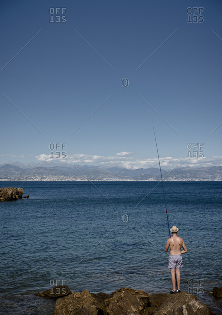 Fishing in the mediterranean sea under the sun near Antibes on the d'Azur in France.