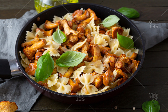 Close up of pasta with chanterelle mushrooms in pan