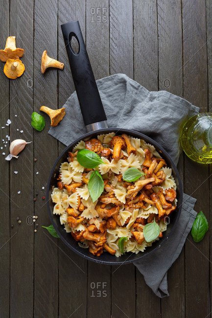 Overhead view of pasta with chanterelle mushrooms in pan