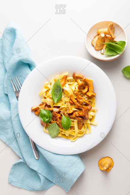Pasta tagliatelle with chanterelle on a white plate