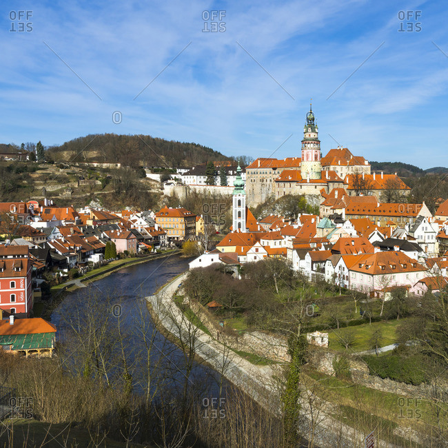 April 3, 2018: Vltava River by State Castle and Chateau Cesky Krumlov in town, UNESCO, Cesky Krumlov, South Bohemian Region, Czech Republic
