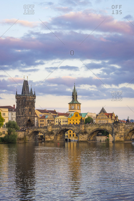 June 13, 2017: Charles Bridge and Old Town Bridge Tower against sky at sunset, Prague, Bohemia, Czech Republic