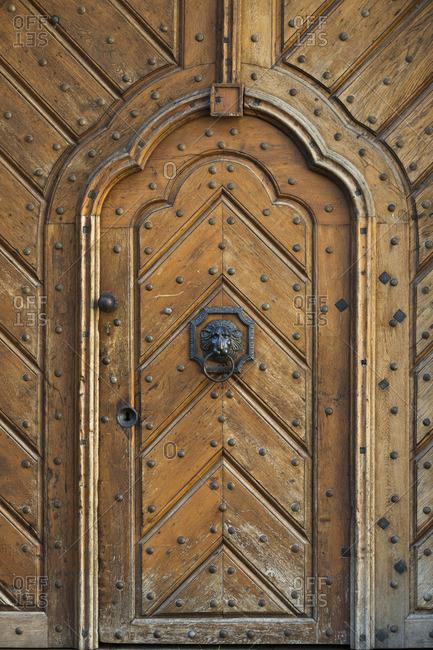 Wooden door with lion shaped door knob, Prague, Bohemia, Czech Republic