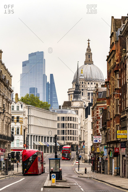 April 25, 2020: UK, England, London, City of London. Red London double-decker buses on Fleet Street & St. Paul's cathedral
