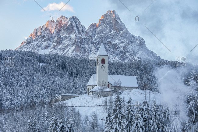 The church of Versciaco, in the background the Tre Scarperi peak, Innichen, dolomites, Alta Pusteria valley, Trentino Alto Adige, Italy