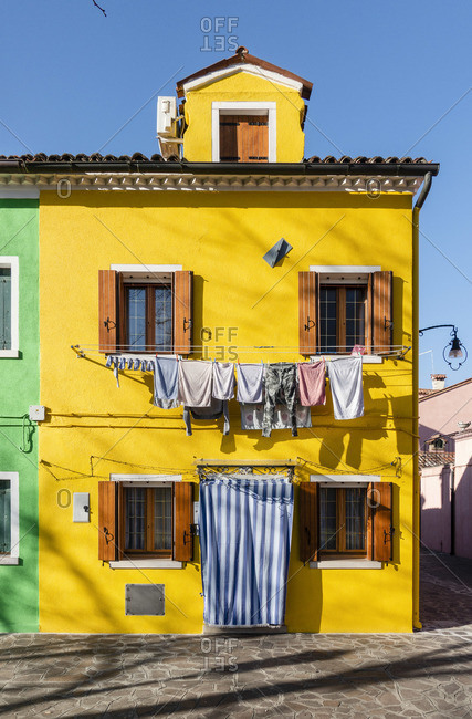 The colored houses of the colorful Burano village, Venice, Italy
