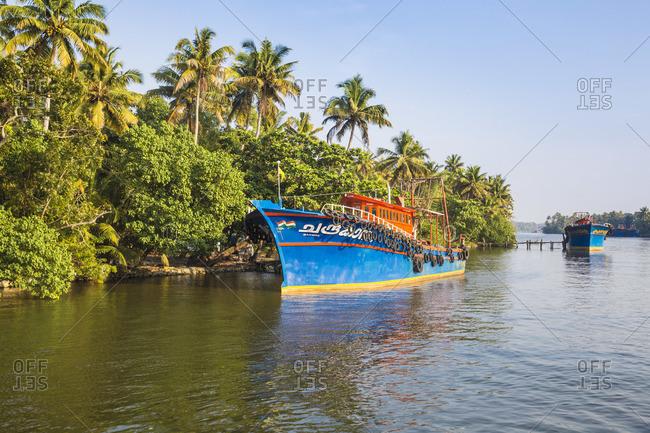 January 30, 2020: India, Kerala, Kollam, Fishing trawlers on Backwaters