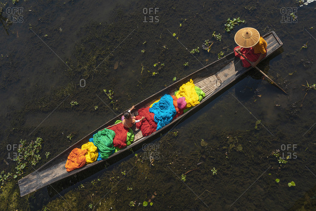 February 14, 2020: Top view of a boat with colorful fabric and yarn at Lake Inle, Nyaungshwe Township, Taunggyi District, Shan State, Myanmar