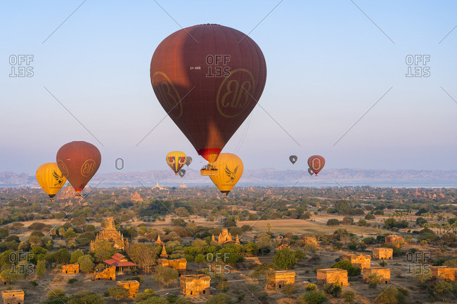 February 12, 2020: Old temple in Bagan and hot-air balloons at sunrise, UNESCO, Old Bagan, Mandalay Region, Myanmar