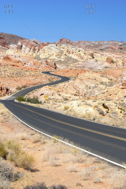 White Domes Road leading to white rock formations after sunrise, Valley of Fire State Park, Nevada, Western United States, USA