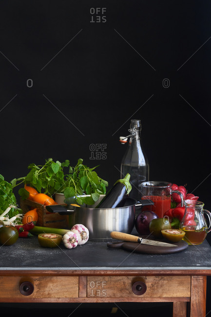 Variety of fresh vegetables and pot on kitchen cart