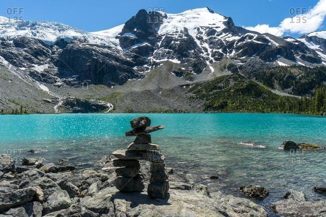 Inuksuk cairn at the edge of a lake, Joffre Lakes Provincial Park, British Columbia, Canada
