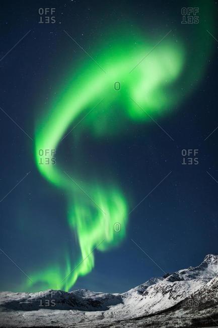Northern lights over mountains near Tromso, Troms og Finnmark, Norway