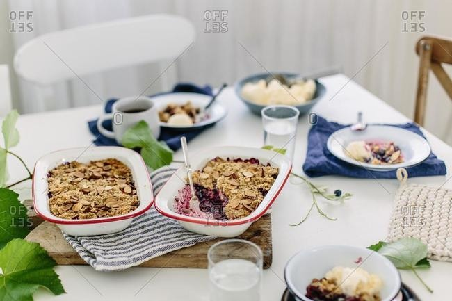 Table setting with blueberry crumble and tea