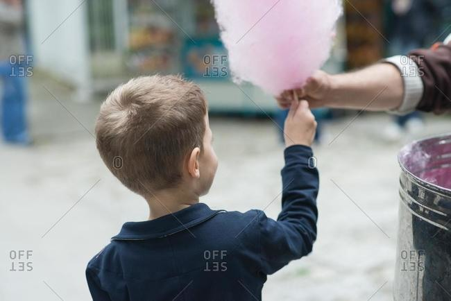 Boy being given candy cotton