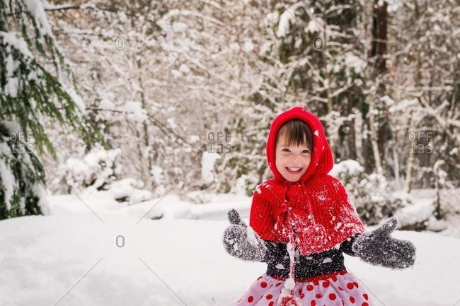 Girl playing in the snow, USA