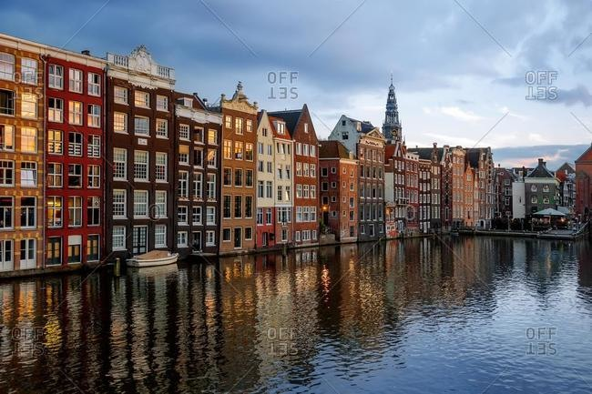 Dancing Houses at the Damrak and the Oudekerksplein Tower, Amsterdam, Netherlands