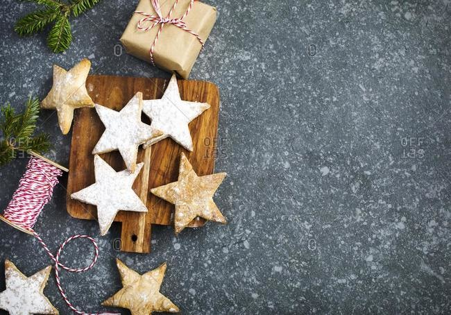 Christmas star shaped cookies and a wrapped Christmas gift