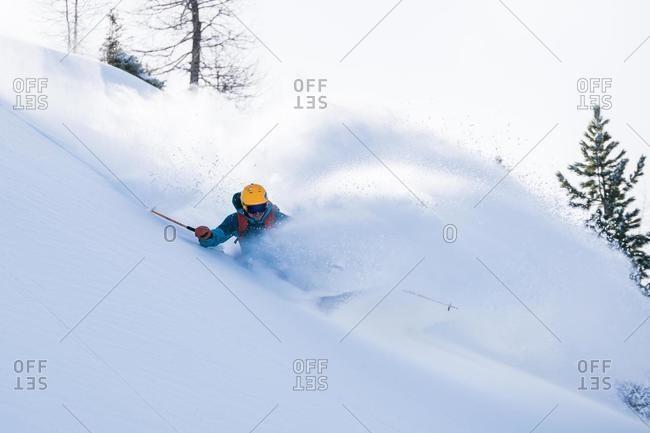 Man skiing in powder snow, Sportgastein, Bad Gastein, Salzburg, Austria