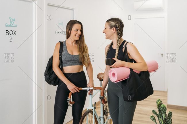 Two sporty women arriving at health club
