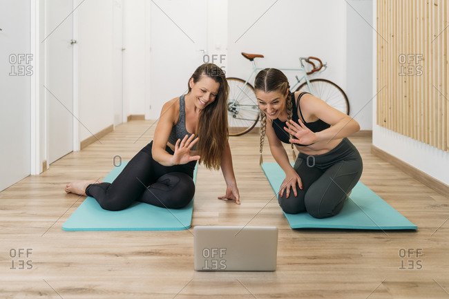 Two sporty women having an online course at health club