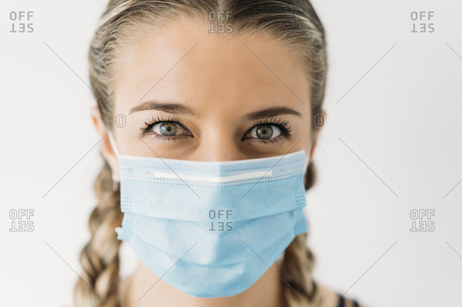 Portrait of beautiful young woman wearing face mask
