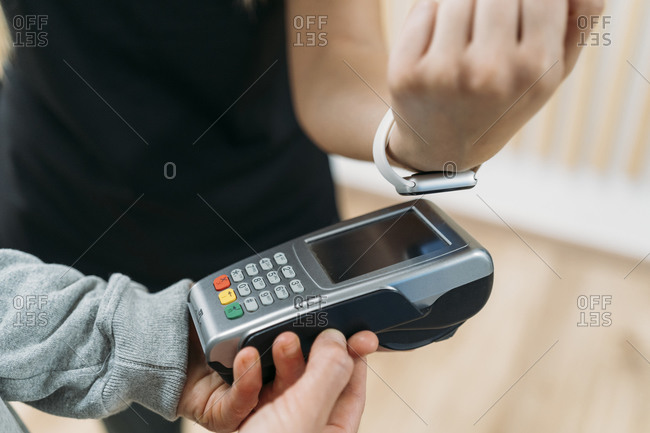 Paying cashless with smartwatch at health club