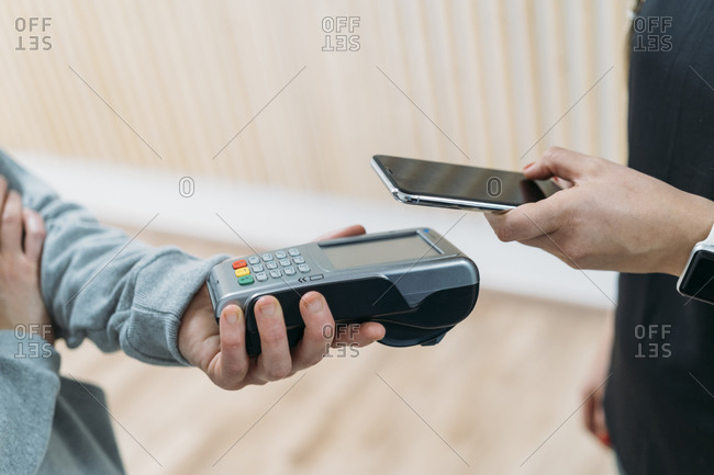 Paying cashless with smartphone at health club