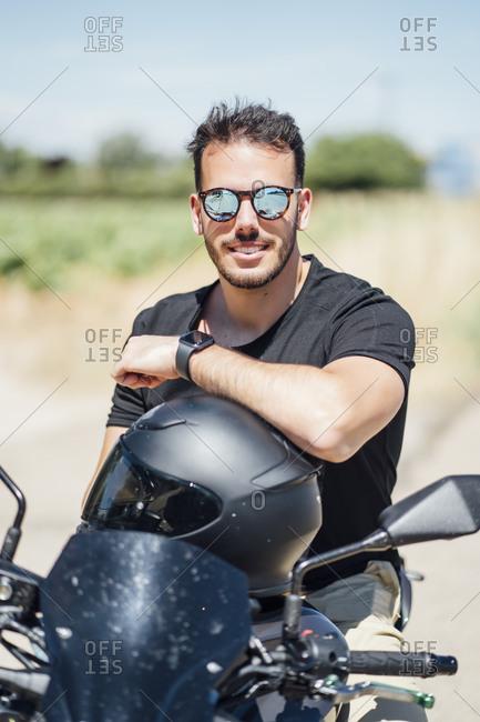 Biker with sunglasses sitting on motorbike