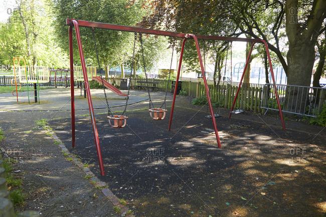 UK- England- London- Swings in empty playground