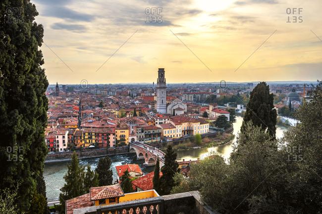 Italy- Veneto- Verona- Riverside city at sunset