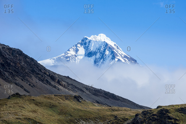 UK- South Georgia and South Sandwich Islands- Grytviken- Mountain peak shrouded in clouds