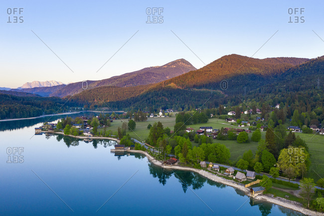 Germany- Bavaria- Kochel am See- Drone view of village on shore of Lake Walchen at springtime dawn