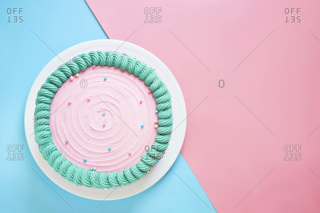 Studio shot of pink birthday cake