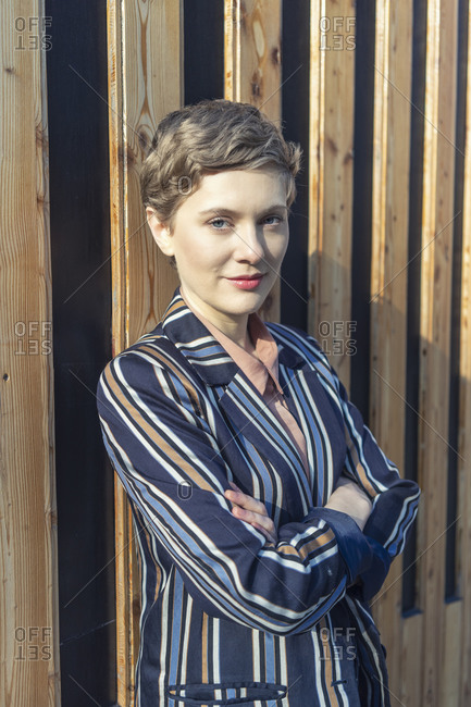 Portrait of businesswoman with short hair wearing striped blazer