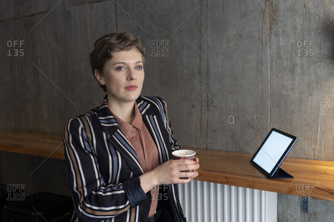 Portrait of freelancer with digital tablet in a coffee shop