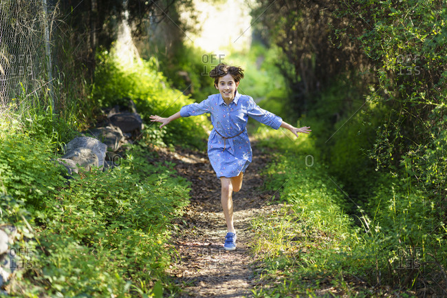 Girl running on a rural path