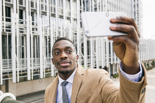 Young businessman taking a selfie in the city
