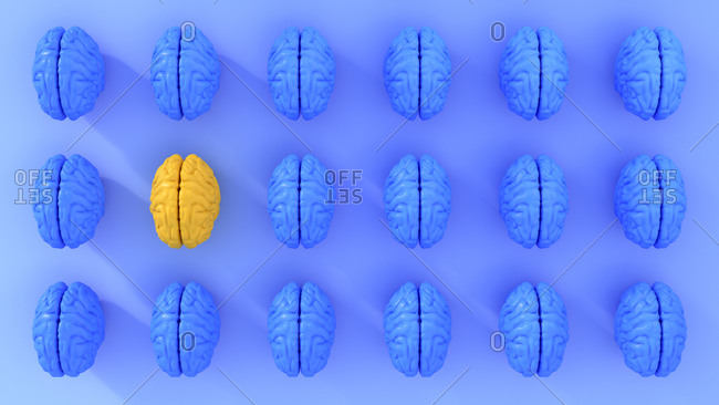 Pattern of rows of blue colored human brains with single yellow one