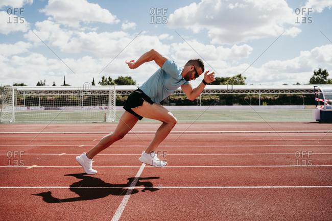 Man running on tartan track