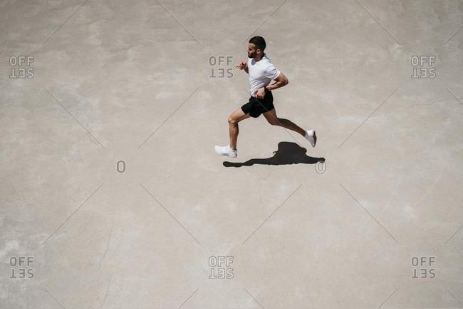 Man running outdoors in sunshine